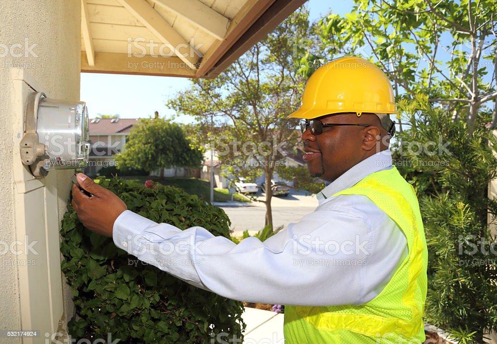 Africa American Smart Meter Technician Left Hand stock photo