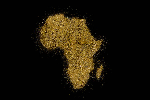 Africa shaped from golden glitter on black (series) stock photo