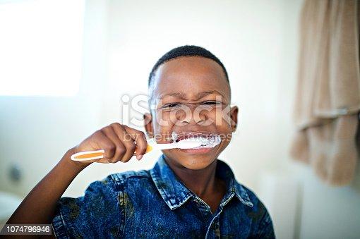 istock African 6-7 years old boy Brushing teeth close-up 1074796946