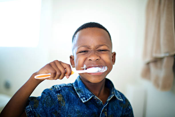 African 6-7 years old boy Brushing teeth close-up stock photo