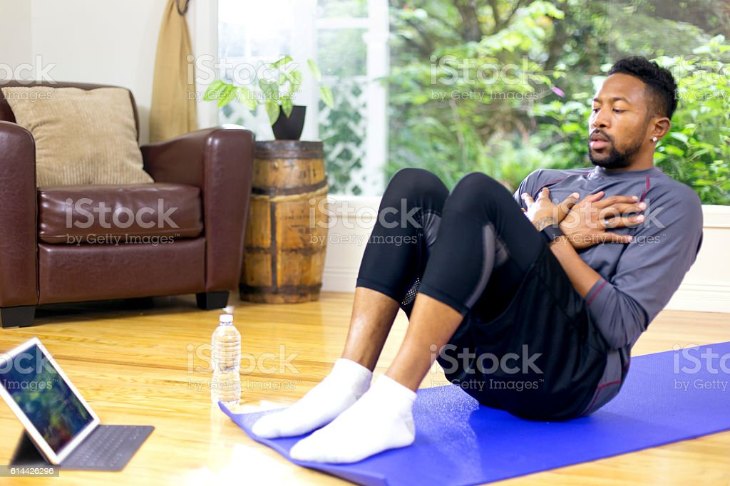 African American adult male doing a core workout stock photo