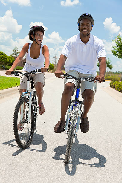 African American Adult Man and Woman Couple Cycling stock photo