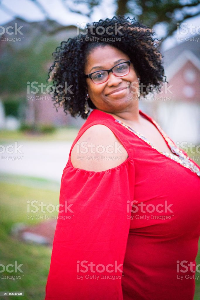 African American adult woman with glasses posing neighborhood standing tall stock photo