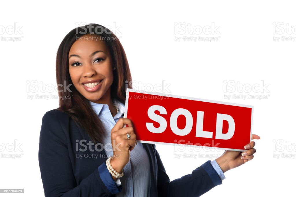 African American Agent Holding Sign stock photo