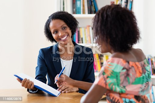 istock African american applicant signing contract 1146820976