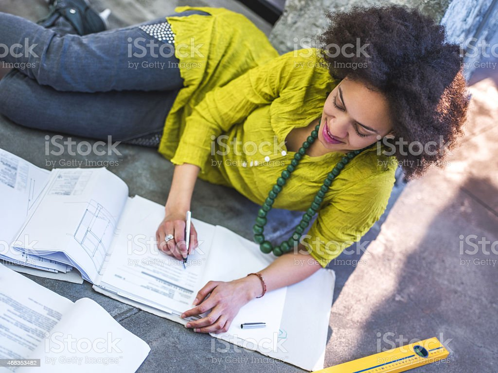 African American architect writing blue print. royalty-free stock photo