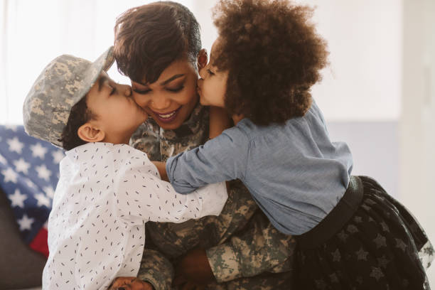 African - American Army Mom African-American army mom is back home. us military stock pictures, royalty-free photos & images
