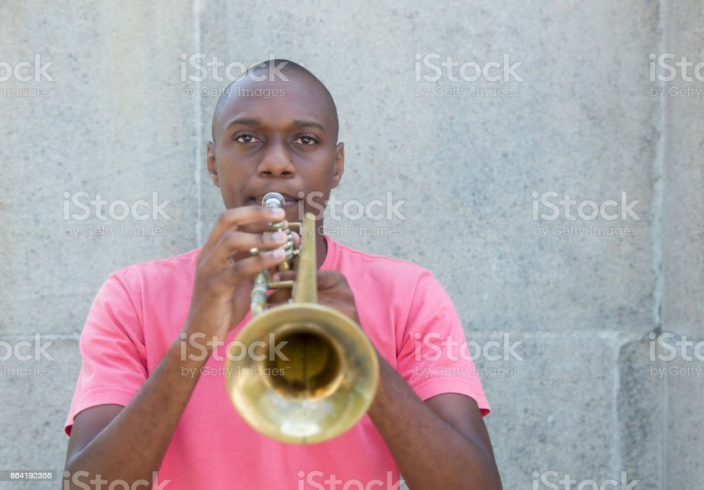 African american artist playing trumpet royalty-free stock photo