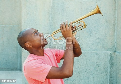 istock African american artist with trumpet 864181360