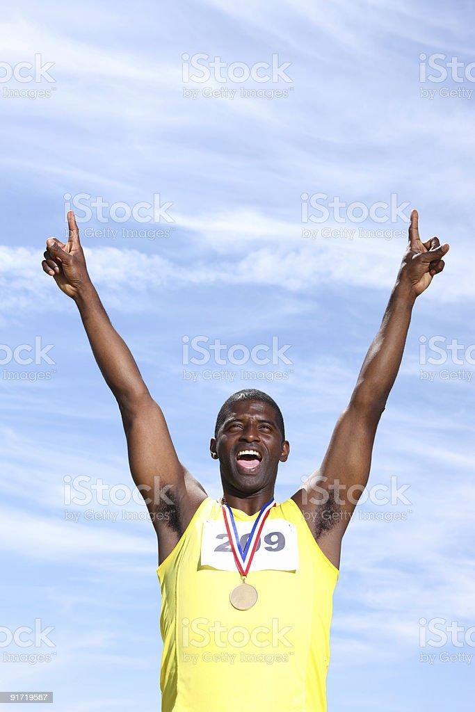 African American athlete celebrating royalty-free stock photo
