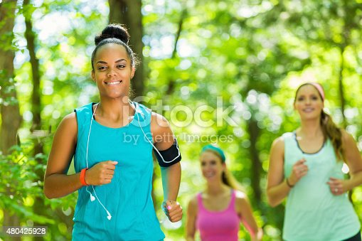 1051098428 istock photo African American athletic woman smiling as she runs with friends 480425928