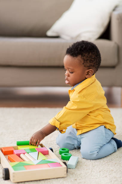 african american baby boy playing with toy blocks stock photo