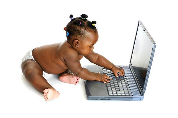 African American Baby Girl Using A Laptop stock photo