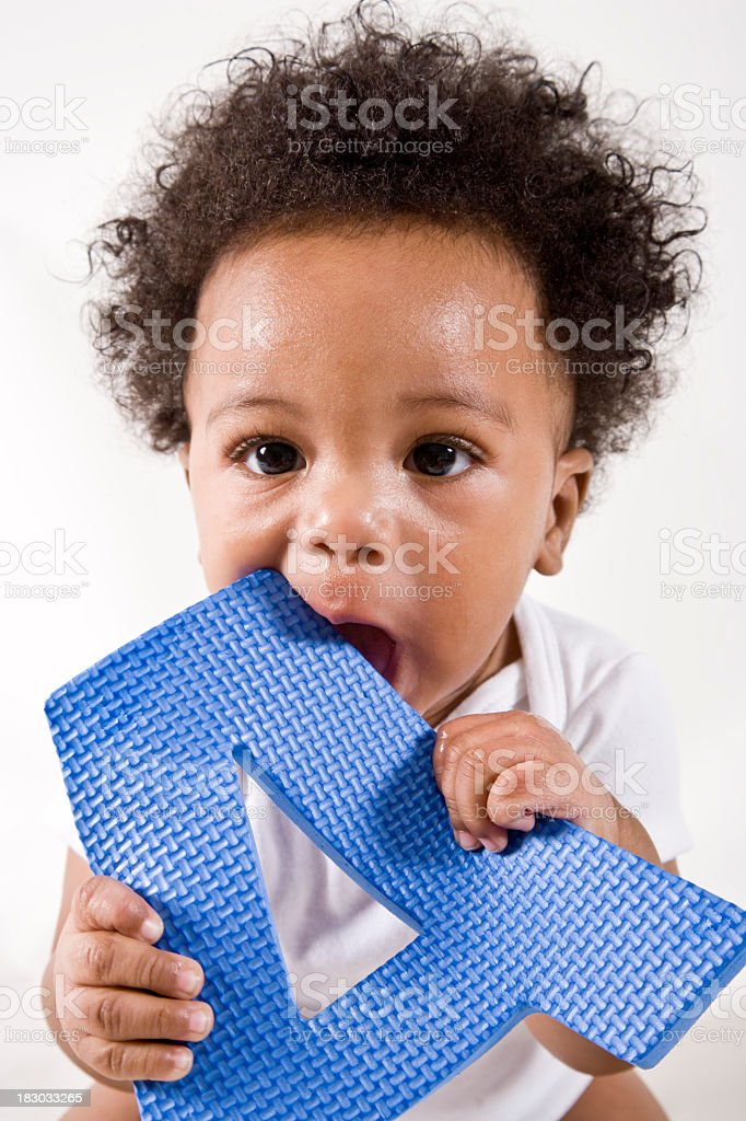 African American baby playing with the letter A stock photo