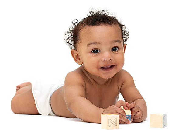 African American baby with blocks stock photo