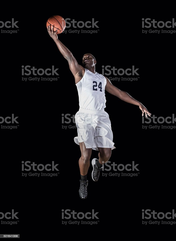 African American Basketball Player scoring a layup stock photo