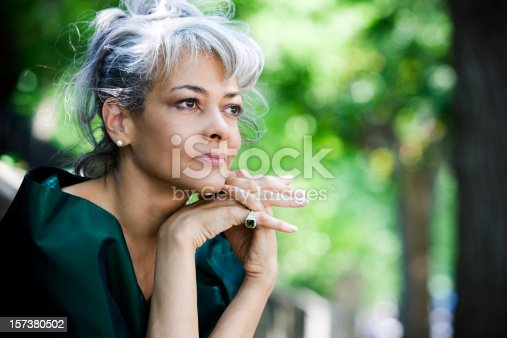 istock African American Beautiful Senior Woman Sitting Outdoors, Copy Space 157380502