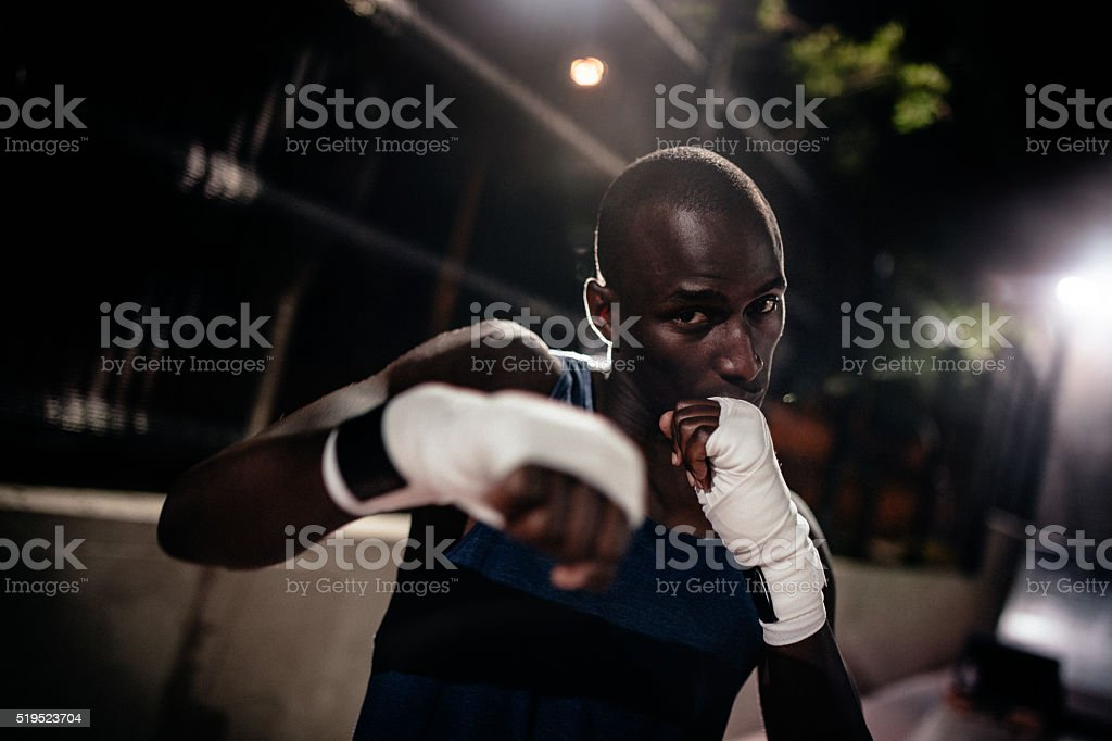 African american boxer athlete punching towards the camera stock photo