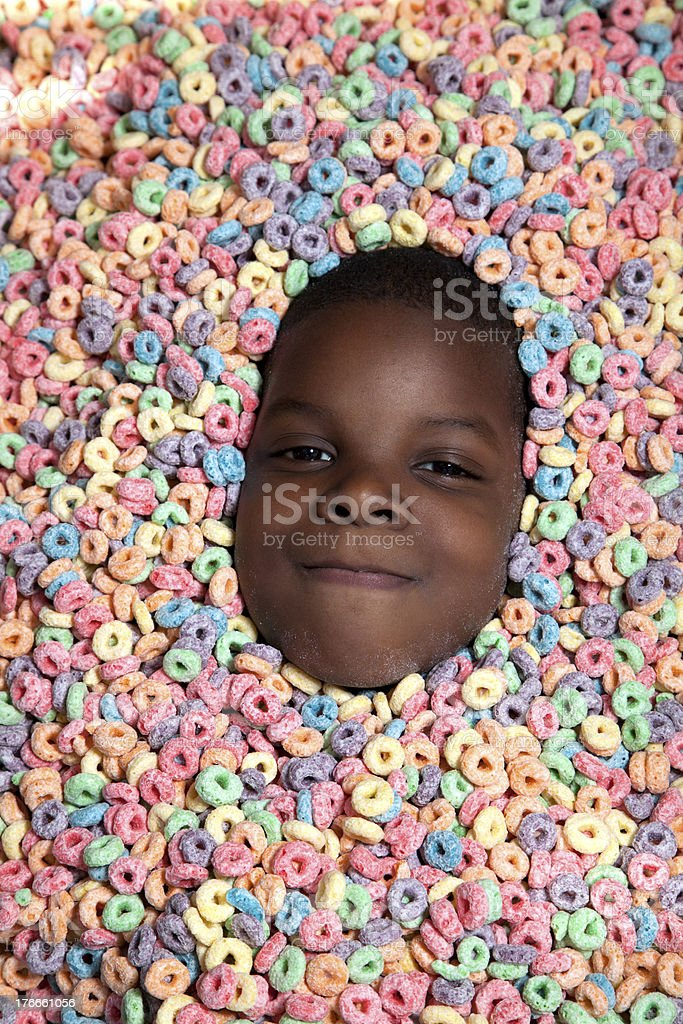 African American boy buried in cereal royalty-free stock photo