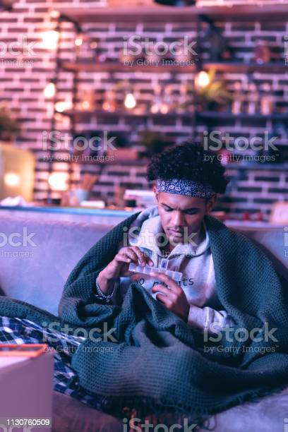 African American Boy Checking How Many Pills He Left To Taking Stock Photo - Download Image Now