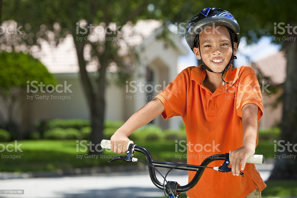 African American Boy Child Riding Bike stock photo