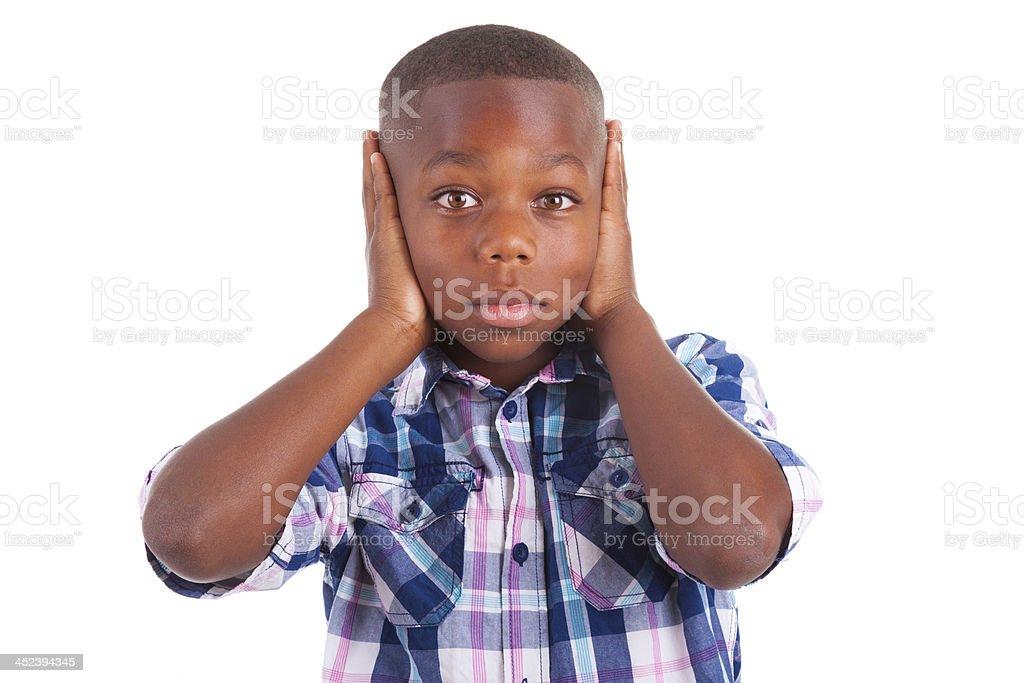 African American boy hiding ears  - Black people stock photo