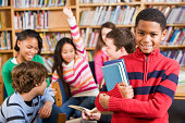 istock African American boy in school library smiling 168248982