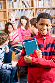 istock African American boy in school library smiling 182065545