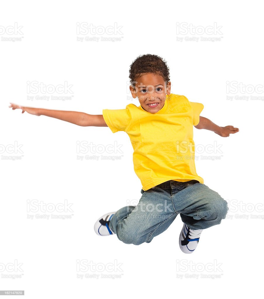 african american boy jumping stock photo