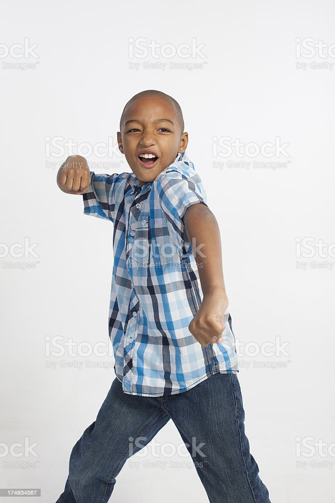 African American boy making motions to punch on white background. royalty-free stock photo