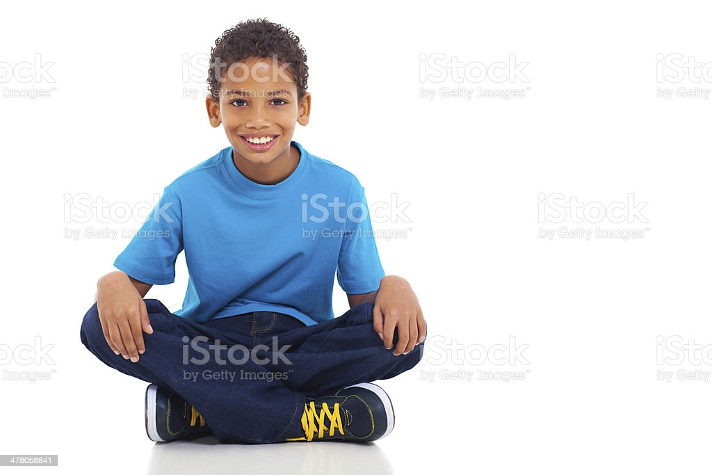 african american boy sitting on white background stock photo