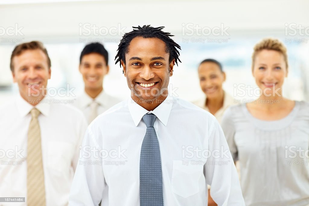 African American busines man with colleagues at the back royalty-free stock photo