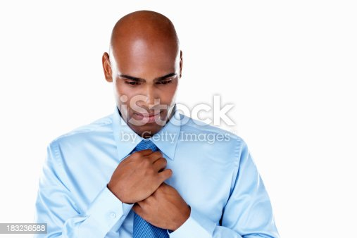 973213156 istock photo African American business man adjusting tie against white 183236588