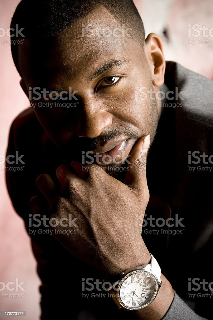 African American Business Man Resting Chin on Hand royalty-free stock photo