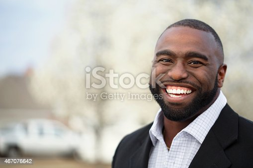 825083248istockphoto African American Business Man Smiling 467076642