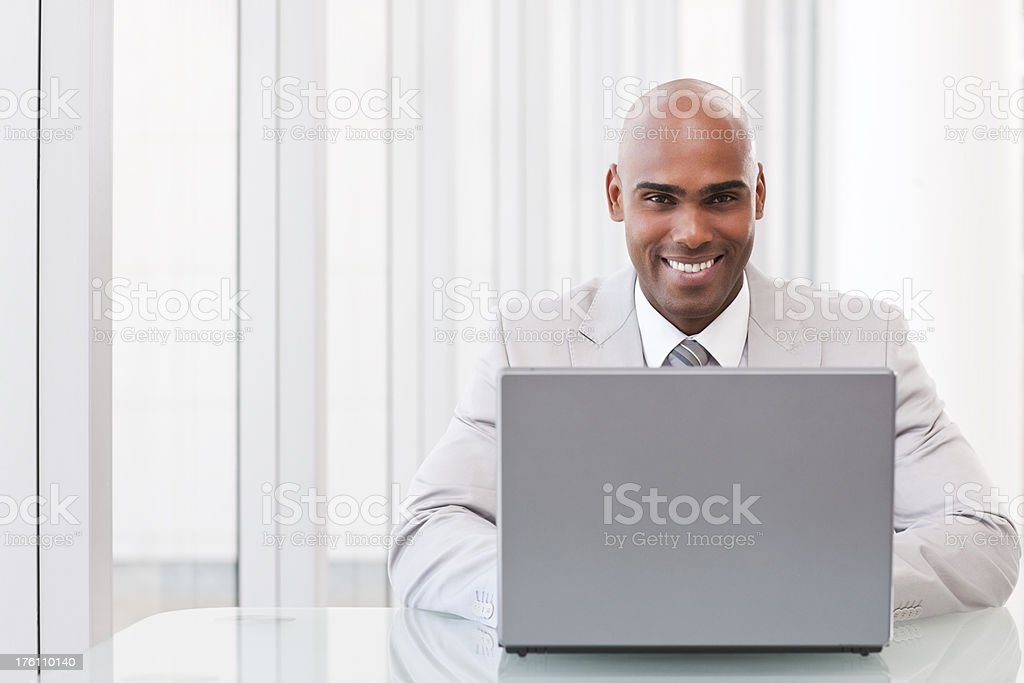African American business man working on laptop royalty-free stock photo