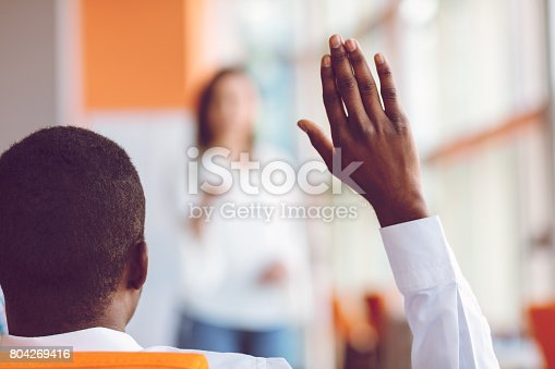istock African american Business people Raising there Hand Up at a Conference to answer a question 804269416