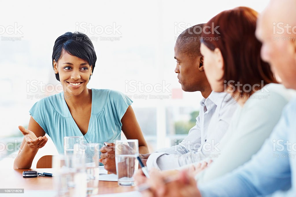 African American business woman discussing with her team royalty-free stock photo