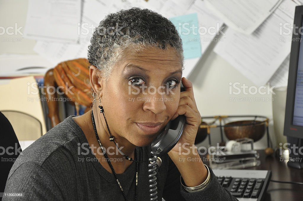 African American Business Woman on Phone in Office royalty-free stock photo