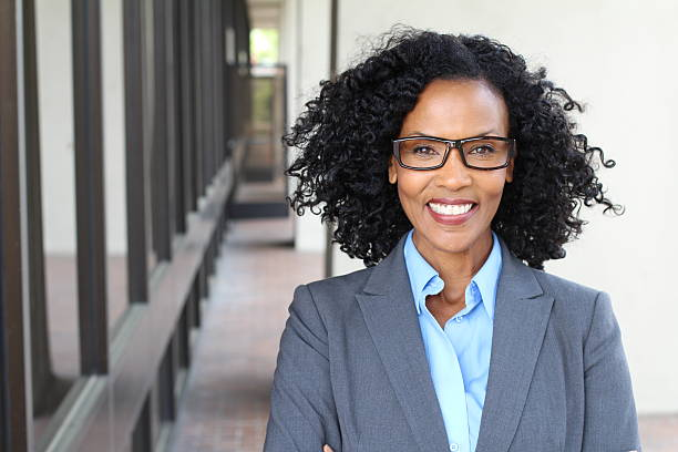 African American business woman wearing glasses stock photo
