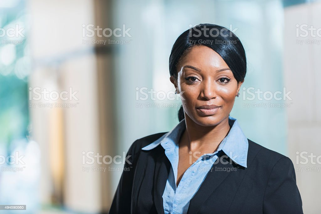 African American business woman wearing suit stock photo