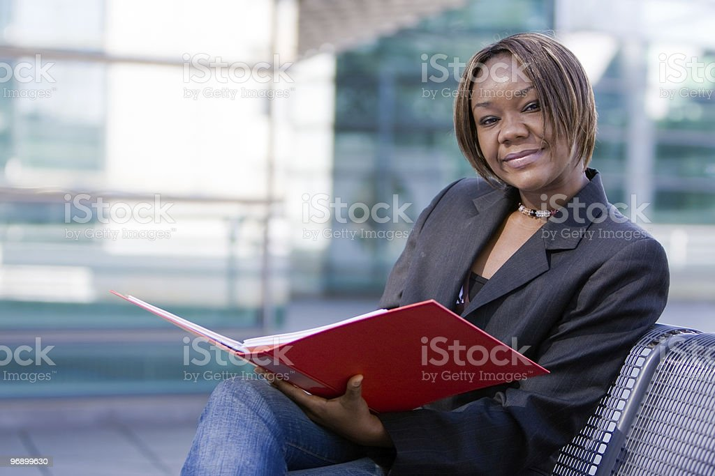 African american business woman with folder royalty-free stock photo