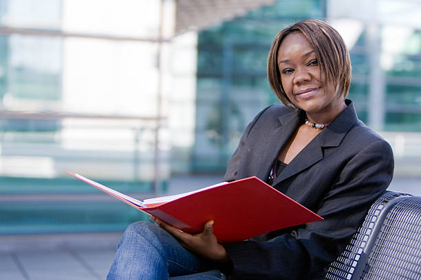 African american business woman with folder stock photo