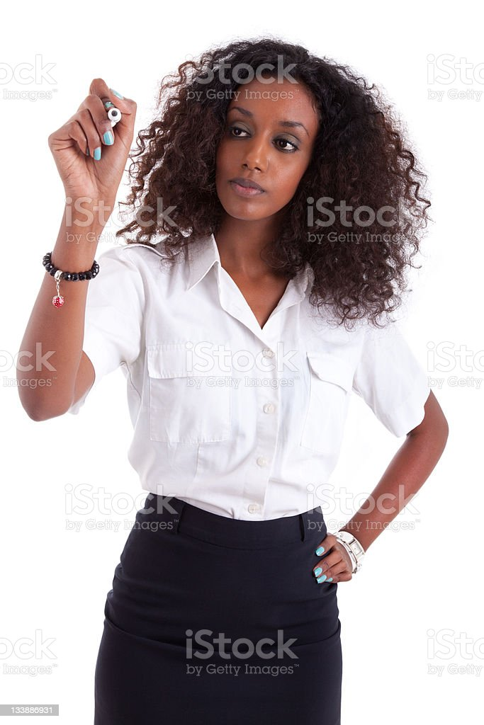 African american business woman  writing something on glass boar stock photo