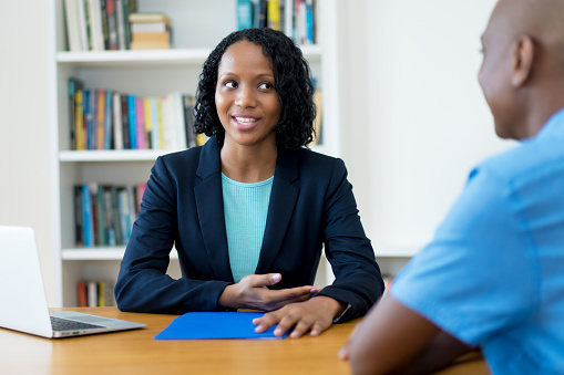 istock African american businessman and businesswoman in discussion 1210047552