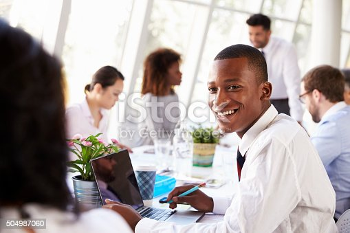 504987926 istock photo African American Businessman At Meeting With Colleagues 504987060