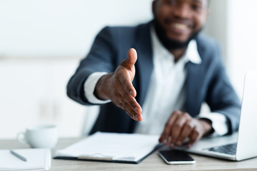 African American businessman extending hand to shake