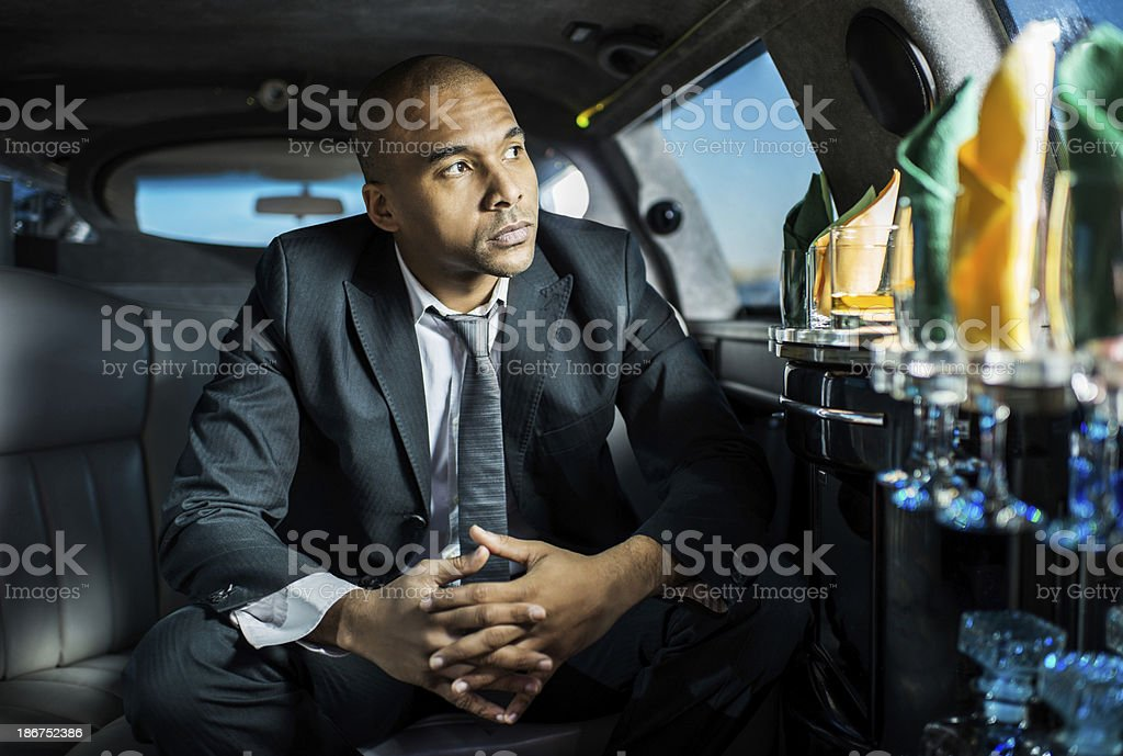 African American businessman in a limousine. royalty-free stock photo