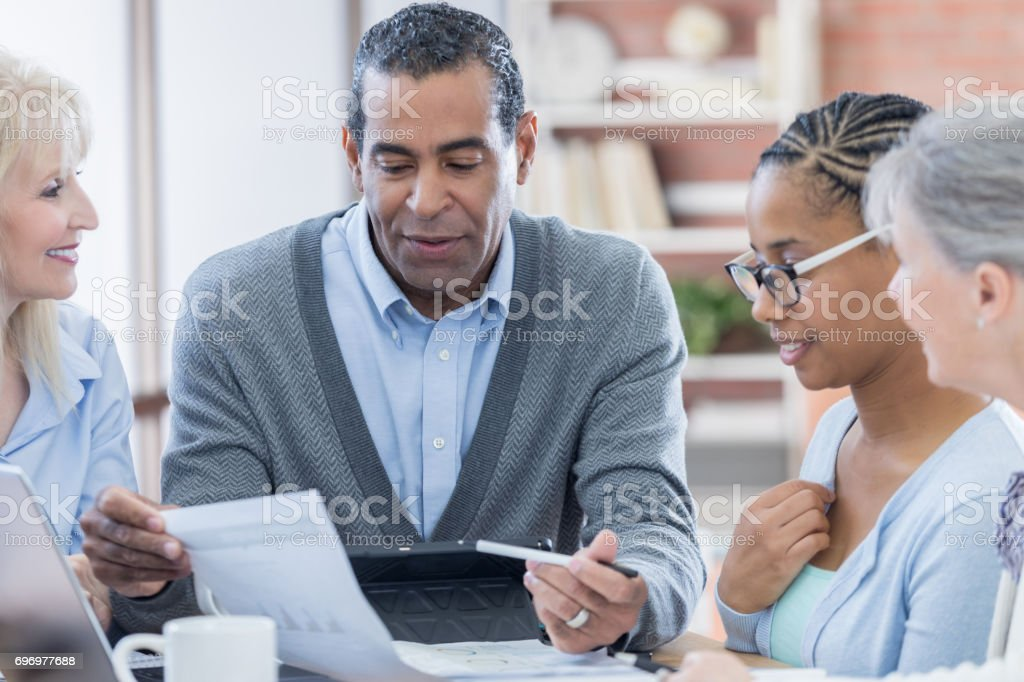 African American businessman leads financial meeting stock photo