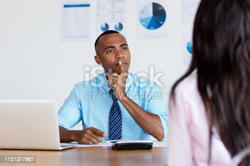 istock African american businessman listening to employee 1131377987